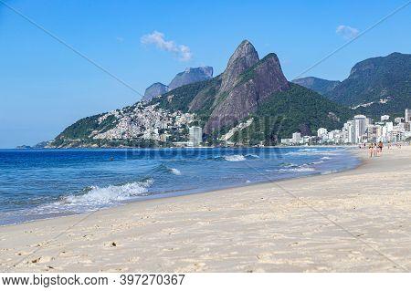 Rio De Janeiro, Brazil - December 19, 2019: Ipanema Beach At The Morning. Two Brother Mountain At Ba