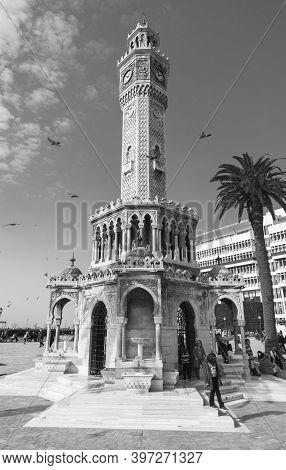 Izmir, Turkey - February 5, 2015: Ordinary People Walk On Konak Square Near The Historical Clock Tow