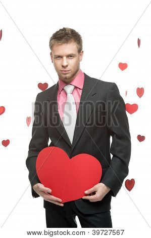 businessman holding big red heart