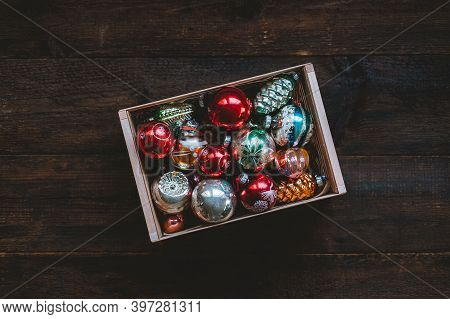 Vintage Christmas Ornaments, Antique Retro Christmas Glass Baubles, Balls In Wooden Box On Rustic Ba