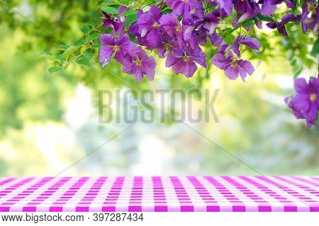 Natural Summertime Cooking Template - Fresh Green Leaves And Violet Flowers Of Clematis Over An Empt