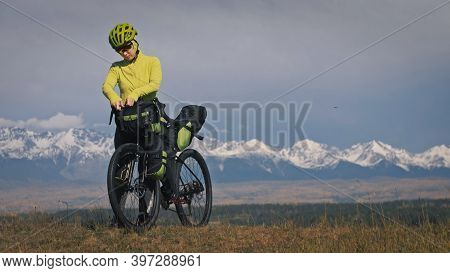 The Woman Travel On Mixed Terrain Cycle Touring With Bikepacking. The Traveler Journey With Bicycle