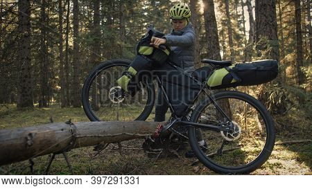 The Woman Travel On Mixed Terrain Cycle Touring With Bike Bikepacking. The Traveler Journey With Bic
