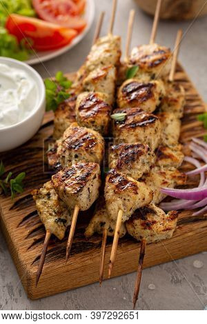 Greek Chicken Souvlaki With Tzatziki Sauce And Fresh Vegetables, Grilled Kebabs
