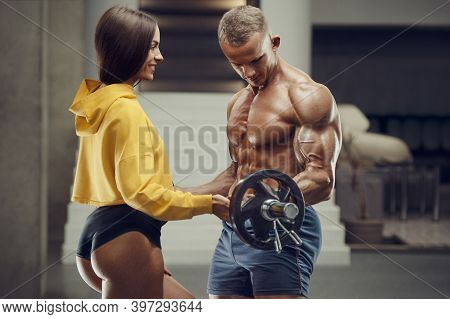 Sporty Fitness Couple Working Out In Gym