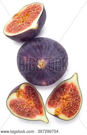 Whole And Sliced Figs With Leaves Isolated