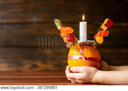 Orange Christingle Is A Symbolic Object Used In The Advent, Christmas And Epiphany Services Of Many