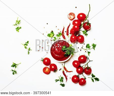 Tomato Ketchup Sauce With Spices And Herbs With Cherry Tomatoes In A Bowl On White Food Background,