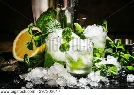 Alcoholic Cocktail Vodka Smash With Vodka, Sugar Syrup, Soda, Lime, Mint And Crushed Ice, Black Back