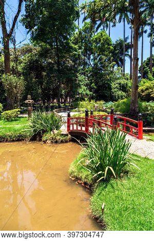 Rio De Janeiro. Red Bridge In The Japanese Garden In The Botanical Garden Of Rio De Janeiro, Brazil.