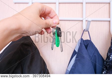Woman Hand Hanging Keys On A Ring On A Coat Rack Hook In A Hallway, Anteroom At Home, Home Safety An