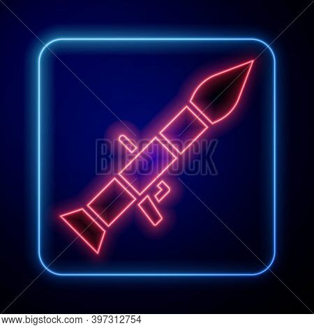 Glowing Neon Rocket Launcher With Missile Icon Isolated On Blue Background. Vector