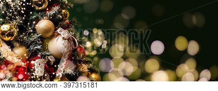 Christmas Tree With Baubles And Blurred Shiny Lights
