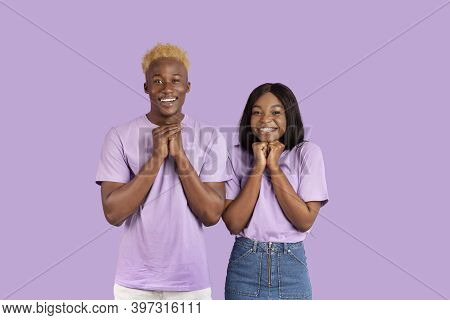 Excited Black Couple Anticipating Something Wonderful, Making Wish, Begging Or Praying Over Violet S
