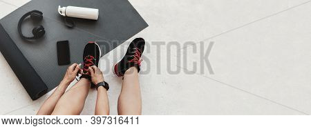 Morning Workout Routine In Home Gym, Fitness Motivation And Muscle Training. Woman Tying Shoelaces,