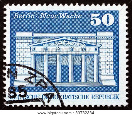 a stamp printed in GDR shows New Guardhouse, War Memorial, Memorial for the Fallen of the War, Berlin, circa 1973 poster