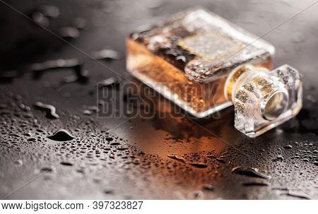 Female Wet Perfume On Grey Wet Table