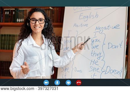 Distance Education And Technology. Woman In Glasses And Headset Having Video Conference, Teaching Fo