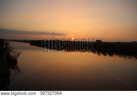 Sunset Over The River Rotte In Zevenhuizen With Windmills Of The Molenviergang In The Tweemanspolder