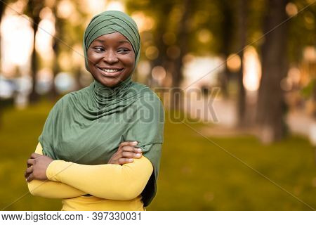 Modern Muslim Woman. Portrait Of Black Islamic Lady In Hijab Standing Outdoors, Confident Religious