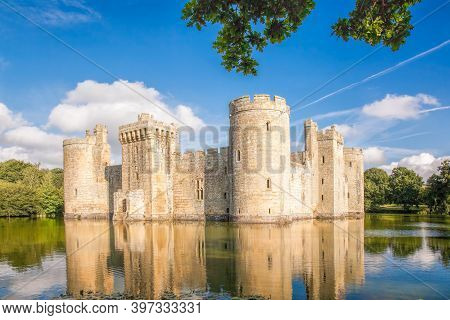Historic Bodiam Castle With Leaves In East Sussex, England