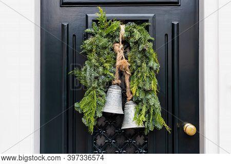 Christmas Wreath With Bells On Entrance Vintage Black Door Outside. Veranda Front Door Decorated By
