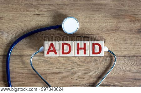 Adhd Symbol. Concept Word 'adhd, Attention Deficit Hyperactivity Disorder' On Cubes On A Beautiful W