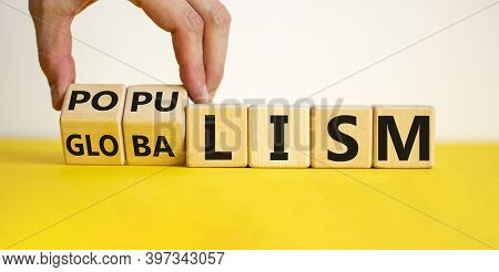 Populism Or Globalism. Hand Turns Cubes And Changes Word 'globalism' To 'populism'. Beautiful Yellow