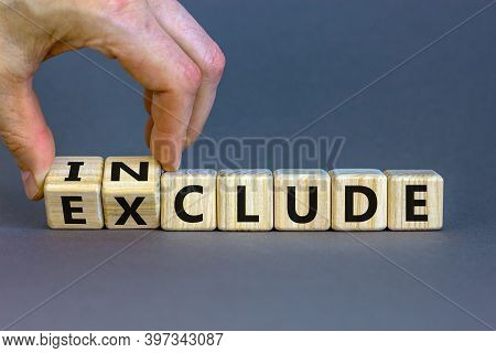 Symbol For A Better Inclusion. Male Hand Turns Cubes And Changes Word Exclude To Include. Beautiful