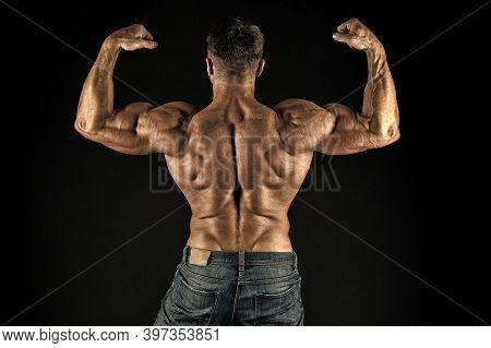 Grow Strong. Bodybuilder Flex Arms Back View. Sports Coach Black Background. Sportsman Show Biceps T