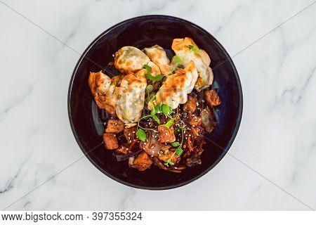 Plant-based Food, Vegan Gyozas With Teriyaki Vegetables And Marinated Tofu Bites
