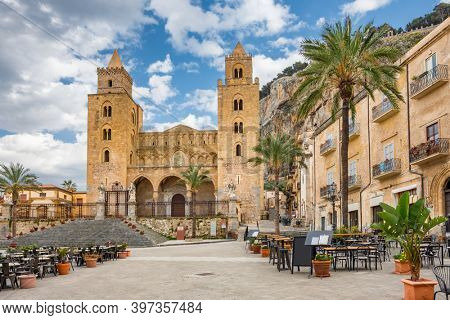 Panoramic view of Cathedral Basilica of Cefalu or Duomo di Cefalu and square Piazza del Duomo in the old town of coastal city Cefalu, Sicily, Italy