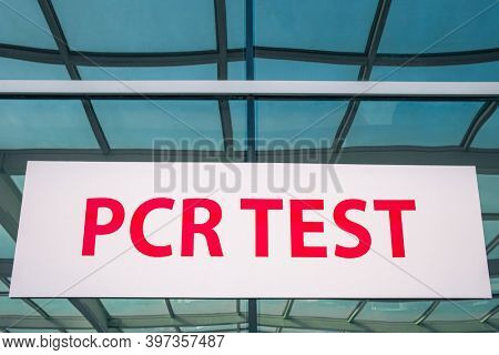 Sign for the PCR test in hospital close-up. Coronavirus COVID-19 testing area sign. PCR or Polymerase Chain Reaction diagnostic center