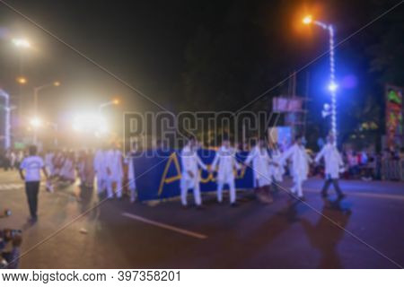 Blurred Image Of Bengali Hindu Gentlemen Dressed In Whiite Traditional Indian Dresses Are Walking At