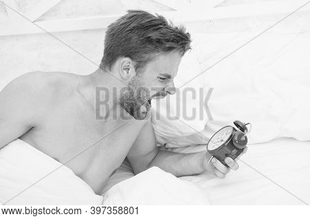 Struggling With Deadline. Angry Guy Shout At Alarm Clock. Sexy Man Lying In Bed. Lack Of Time. Deadl