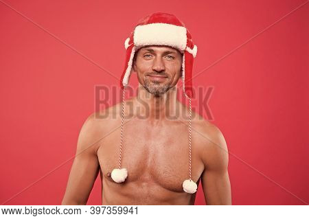 Male In Earflap Winter Hat. Happy New Year. Xmas Party For Adult. Handsome Santa Feel Warm And Hot.