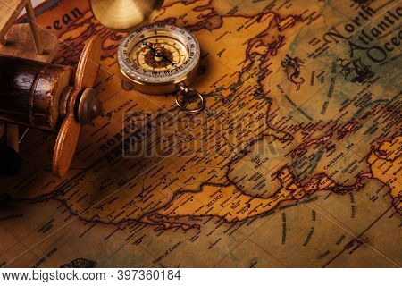 Old Compass Discovery And Wooden Plane On Vintage Paper Antique World Map Background, Retro Style Ca