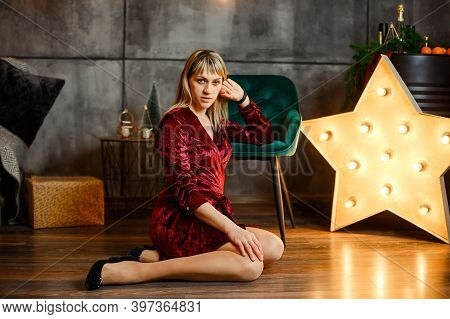 Pretty Female Posing. Portrait Of Excited Beautiful Woman. Young Woman In Christmas Interior. Cozy C