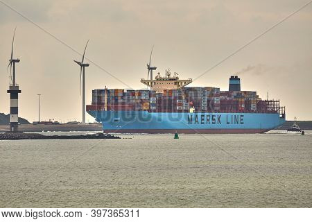 ROTTERDAM, THE NETHERLANDS - CIRCA 2019: Maersk container ship entering the Port of Rotterdam. It's the busiest cargo prot of Europe