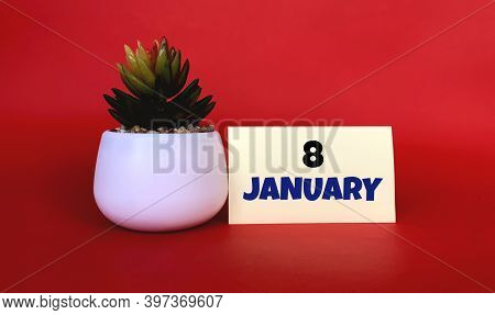 January 8 On A Yellow Sticker.next To It Is A Pot With A Flower On A Red Background .beginning Of Ye