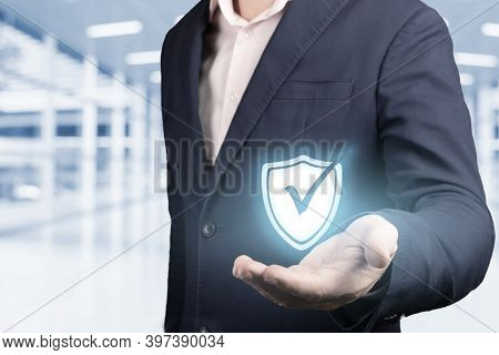 Business Information Security Concept. Businessman Holds Security Symbol In Hand. Concept Of Cyber S