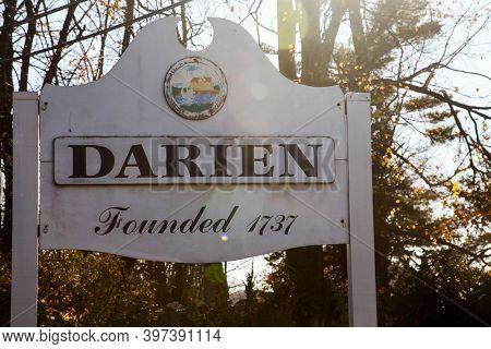 DARIEN,CT, USA-NOVEMBER 29 2020:  Darien town sign near Post road on border line with Stamford