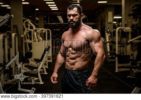 Strong Young Bearded Male With Sport Physique In Athlete Fitness Gym During Training Workout