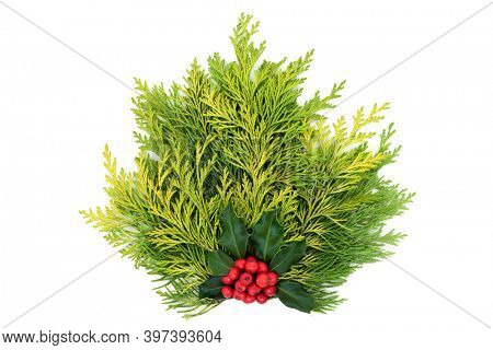 Winter posy decoration of cedar cypress leylandii fir with holly and red berries on white background. Decorative element for Xmas and  New Year,. Flat lay, top view, copy space.
