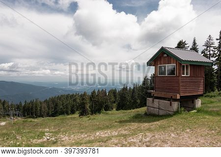 A Small Cabin Near The Older Double Chairlifts At Seymour Mountain With Scenic View In The Backgroun