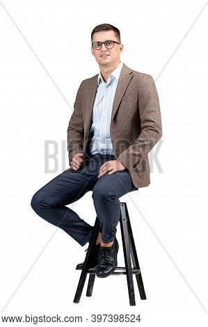 Young Businessman Portrait. Professional Accountant Or Bookkeeper Is Looking To The Camera. Light Gr