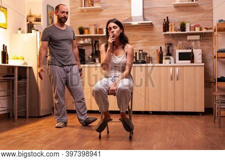 Portrait Of Abused Wife Smoking In The Kitchen. Abused Terrified Beaten Woman Covered In Bruises Suf