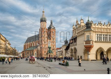 Krakow, Poland - March 1, 2020: Basilica of St. Mary and Market Square at cloudy day in Krakow, Poland