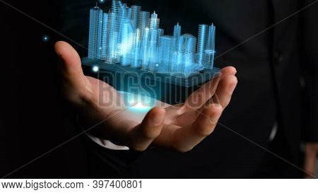 Businessman Holds 3d City Model Showing Augmented Reality Technology . Futuristic Urban Hologram Scr