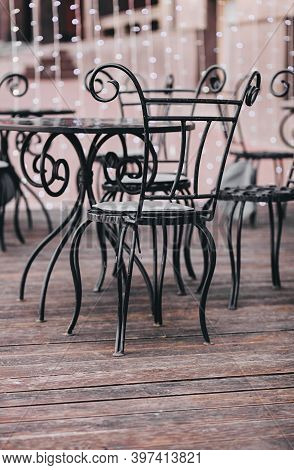 Metal Chairs On The Outdoor Terrace. French Street Bistro